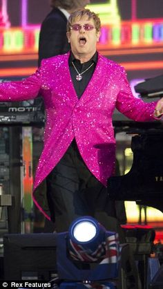"Sir Elton John was dressed in a sparkling bright pink coat as he performed ""Your Song"" and dedicated it to the Queen."