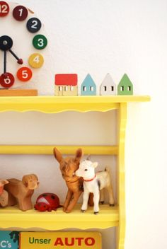 Vintage animals on an adorable yellow shelf