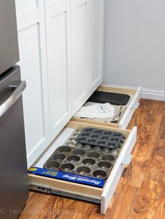 Have you ever considered using that wasted space UNDER your cabinets? Hidden by that toe kick panel is a goldmine in terms of storage space. Add some short custom drawers to store things like cookie sheets and muffin tins. Woah!