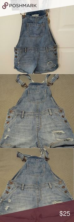 Forever 21 shorts overralls. Size 6. Nwt! Very stilish. Distressed light blue denim. Perfect for summer. Never worn. New without tags. Perfect condition. Firm price. Forever 21 Jeans Overalls
