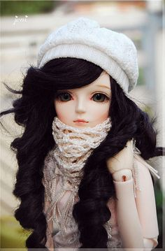 this reminds me of my friend from Latvia ^__^  THis Is A Great Picture. It Looks Like She Is All Bundled Up! :D