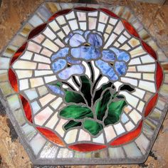Mosaic violets garden stepping stone by Rich Perkins.