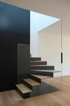 Black Wall with glass stairs. DEP Studio - CASA Red. Modern Interior Design. Contemporary Interior Architecture.