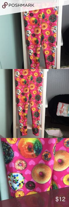 Girls Doughnut Pants Pink Leggings Size M 7/8 These are one of my favorites! They are hot pink leggings that are thicker so they are great for the colder weather. They have colorful doughnuts all over with icing and sprinkles. They are a girls size M 7/8. They were worn once. I have a ton of leggings so bundle and save!!!! Bottoms Leggings
