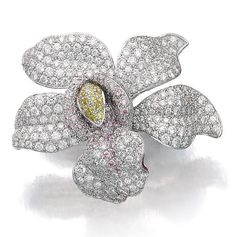 DIAMOND RING, 'CARESSE D'ORCHIDÉES', CARTIER. Designed as an orchid pavé-set with diamonds of pink, yellow and near colourless tints, size 51, signed Cartier and numbered, French assay and partial maker's marks, case stamped Cartier