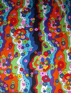RESERVED 1970s Peter Max Era Style Psychedelic Fabric Faces and Flowers Authentic 70s fabric NOS up to 2 yards. $95.00, via Etsy.