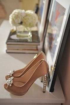 Decorate with your wedding shoes instead of keeping them in a box for years and years. So cute!