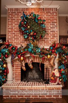 Stunning Peacock Christmas wreath and matching garland.  www.showmedecorating.com