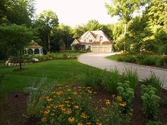 Beautiful landscaping design with a nice driveway idea