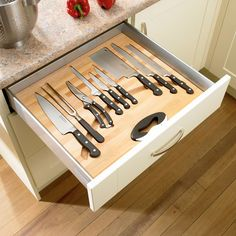 Kitchen Drawer Organization - Design Your Drawers So Everything Has A Place | Each knife in this drawer has a cut out so it always fits just right. And the groove along the bottom lets you easily grab your knife without having to dangerously fumble around with it.