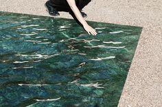 mathieu lehanneur's liquid marble surface spills through french courtyard