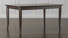 """""""Cabria"""" Dark Extension Dining Table from Crate & Barrel.  Notice how much more graceful the leg is on this table!"""