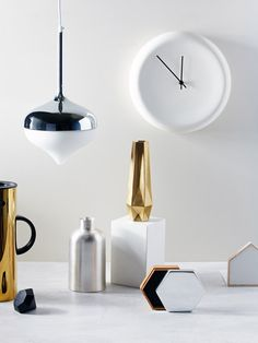 From left to right – Normann Copenhagen Stelton Jug from Safari Living ($220.00),  Diamond Box from Third Drawer Down ($24.00),  Spun Pendant Light, Silver from Evie Group ($595.00), Toru Bottle from Country Road ($60.00),  Tom Dixon Gemm Collection Tall Vase from Third Drawer Down ($133.00),  Ora Clock from Country Road ($59.95), Hex Box silver and gold by Evie Group ($140.00), Mitch Book End from Country Road ($40.00).