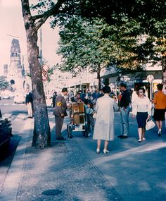 A sidewalk on Kurfürstendamm, the main street of West Berlin. The Kaiser Wilhelm Memorial Church is in the background. The man at left is playing a Leierkasten (hand organ). The armband on his sleeve indicates that he is blind. Main Street, Street View, West Berlin, Depression Treatment, Ronald Reagan, The Past, Germany, Memories, 1960s