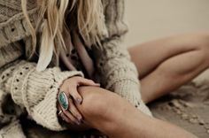 Sweater on a beach with a pretty turquoise ring