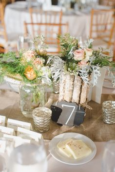 Bark-wrapped cylinders, mason jars and silver mercury votives create a rustic and romantic look for the tables at Angela and Andrew's Audubon wedding: Pill Photography.