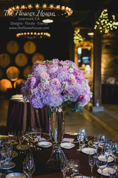 Tall centerpieces in lavenders and blush pinks by theflowerhouse.com