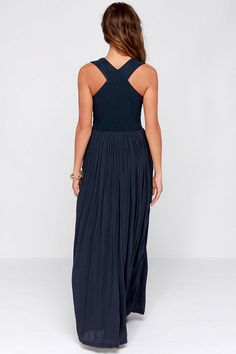 Lulus Exclusive! Everyone will have romantic reveries of you donning the In Your Dreams Navy Blue Maxi Dress! Stretchy navy blue knit forms a sleeveless bodice with a modified racer back, plunging V-neckline, and plenty of unique seams that provide a flattering fit. Ultra lightweight woven fabric adds a bit of Boho flair as it plunges into a fluttering floor-length skirt. Hidden side zipper/hook clasp. Skirt is lined. 95% Polyester, 5% Spandex. Contrast: 100% Rayon. Hand Wash Cold.