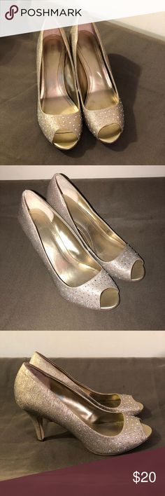 """Beautiful heels! These Monaee peep toe pumps by Style & co. are covered in brilliant rhinestone accents. Make the night sparkle! They are gold, although they look a little different in some of the photos. Gently used, I think my daughter wore them once to a dance. The heel measures 3 & 3/4"""". Style & Co Shoes Heels"""
