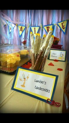 Beauty and the Beast birthday party. Lumiere candlesticks. White chocolate covered pretzels with yellow jelly bean.