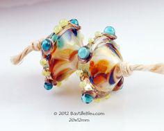 $12 Gold Coast Bicone Pair - Handmade lampwork art beads, jewelry & supplies by Bastille Bleu Lampwork. $12.00, via Etsy.