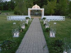 The gazebo is draped in crystals in front of a fountain filled pond