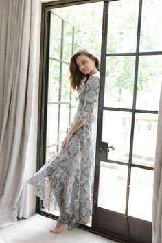 Miranda Kerr wears the Empire Embroidered Dress from Zimmermann Resort RTW 16 collection