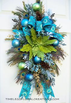 Peacock poinsettia swag https://www.facebook.com/timelesswreaths http://www.timelessfloralcreations.com/
