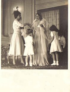 Princess Katherine of Greece and Denmark's Wedding Day. Helping her is Queen Frederica of Greece and Frederica's children, LtoR Princess Irene, Princess Sofia, and Prince Constantine of Greece and Denmark