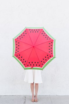 Don't let a rainy day dampen your mood, too. These bright and summery DIY umbrellas will have you looking forward to drizzle. Keep a set in your mud room for kids and guests, or give them away as themed gifts for bridesmaids, co-workers or holidays.