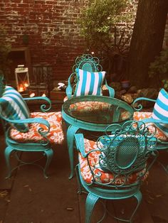 Need to repaint patio furniture thinking turquoise and red pattern cushions!