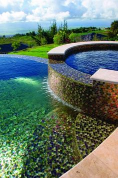 I like how the tiles and lighting in this pool make it look similar to a fresh water lake.