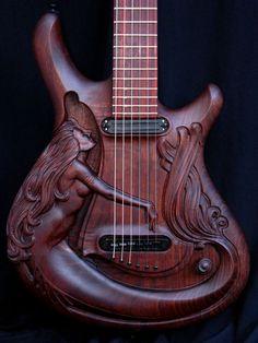 Carved Walnut Guitar Features Mermaid Motif