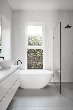 Minimalist Bathroom 282741682842934955 - Archive Of Caulfield House In Melbourne By Pleysier Perkins Source by meganpgray Laundry In Bathroom, White Bathroom, Master Bathroom, Small Bathroom With Bath, Bathroom Cabinets, Bathroom Bin, Bathroom Mirrors, Simple Bathroom, Wet Room With Bath