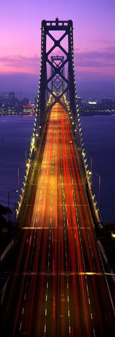 Bay Bridge, San Francisco. Upper deck traffic heading downtown. Beauty shot of GGB's workhorse sister. This is the Treasure Island to SF portion of the bridge, which is still standing. The eastern half of the bridge has been replaced.