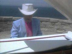 Elton John - Blue Eyes    *childhood memories of my dad singin' this song* =)