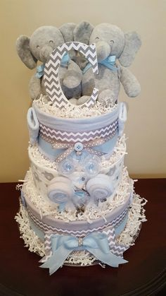 Twinning! Twin boys Elephant baby shower! Diaper cake centerpiece gift! check out my Facebook page Simply Showers for more pics and orders.