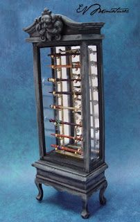 Miniature wizard wand display cabinet (1/12 scale) by EVMiniatures.