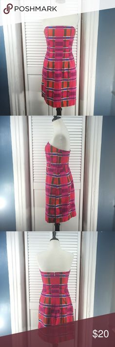 """Banana Republic Plaid Pink Strapless Dress Size 6 Banana Republic Colorful Plaid Dress. Strapless. Fitted and boned bodice. Side seam pockets. Back zipper.   Material:   • 100% cotton   • lining:  100% polyester   Approximate measurements (measured flat):   • bust: 15"""" • waist: 14"""" • length: 28.5  Excellent used condition. No signs of wear. 122816-350 Banana Republic Dresses Strapless"""