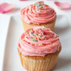 strawberry cupcakes with pink swirl icing.