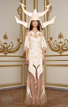 Givenchy Spring 2011 couture collection by Riccardo Tisci - the helmet is absurd, but the dress is lovely.