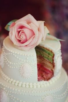Okay girls..have me an idea. Ask white outside and navy inside. Or whatever color you think. Rainbow layer wedding cake