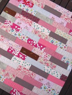"Red Pepper Quilts: Pretty in Pink This baby quilt is made from rows of ""bricks"" measuring 3 inches x 9 inches including the seam allowances. It was pieced in rows, 18 rows in total, with the finished quilt measuring 38.5 inches x 44.5 inches."
