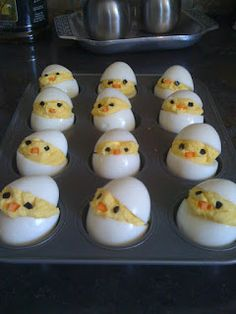 Deviled Egg Chicks: Cut the eggs horizontally when the eggs are standing tall. Divide them about 2/3 tall instead of cutting them in half. It makes them look more like little shell caps that way. Tiny bits of olives for eyes and little triangles for the beaks from a carrot. My little chicks were transported to the party in a muffin tin.