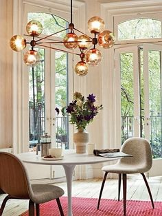 Love the Saarinen table and light fixture. Beautiful and Open. The Light Fixture is a Great Focal Piece.