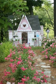 I like the simple wavy gingerbread trim.  It would be easy to add to the girls' playhouse.