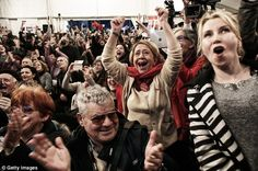 Jubilant: Syriza supporters celebrate victory in the Greek general election in which the anti-austerity party triumphed over the ruling conservatives. Critics say it could plummet the country back into financial danger
