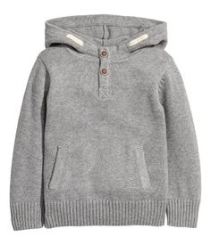 Gray melange. Knit hooded sweater in soft cotton with a button placket and kangaroo pocket at front.