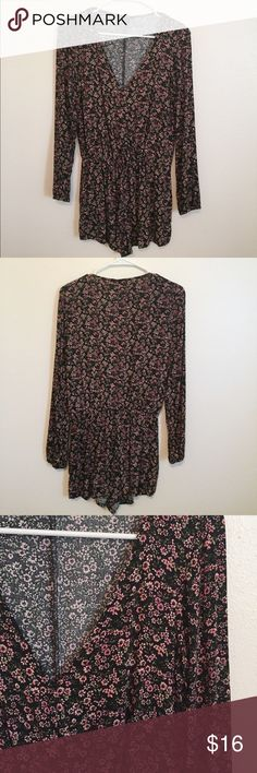 Floral romper A floral romper from forever 21 in a size small. Has long sleeves and a v neck. Has never been worn so still in great condition! Forever 21 Dresses