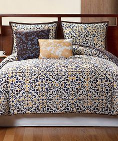 This sophisticated five-piece set brings a sense of fabulous fashion to bedroom décor. With a bold blend of vibrant colors and a trendy pattern, it's perfect for personalizing a bedroom in need of a makeover.